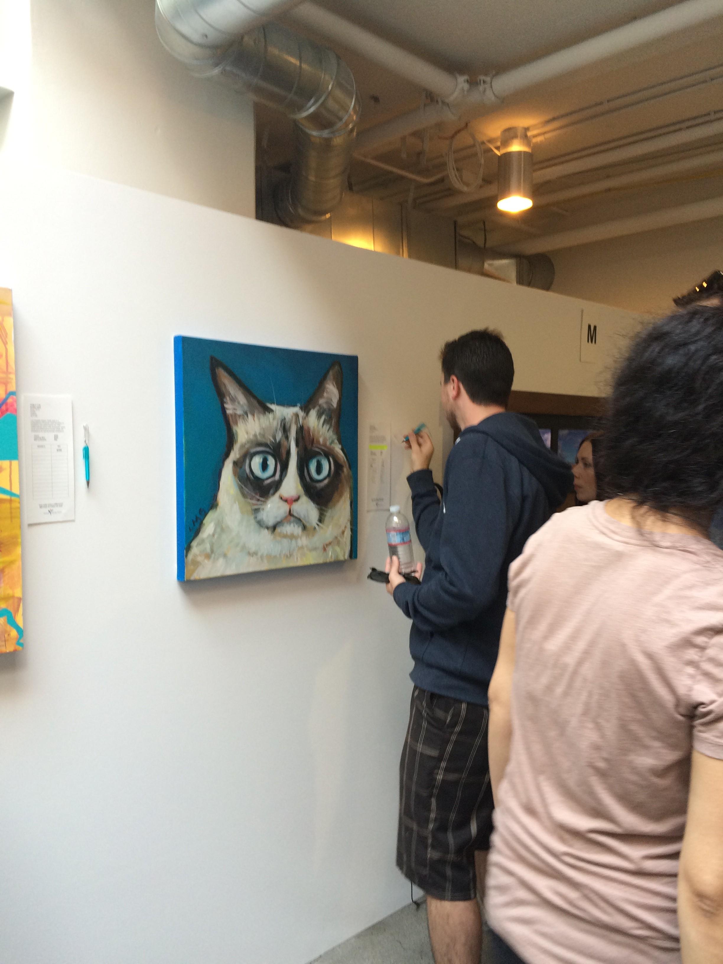 Man bidding on my painting