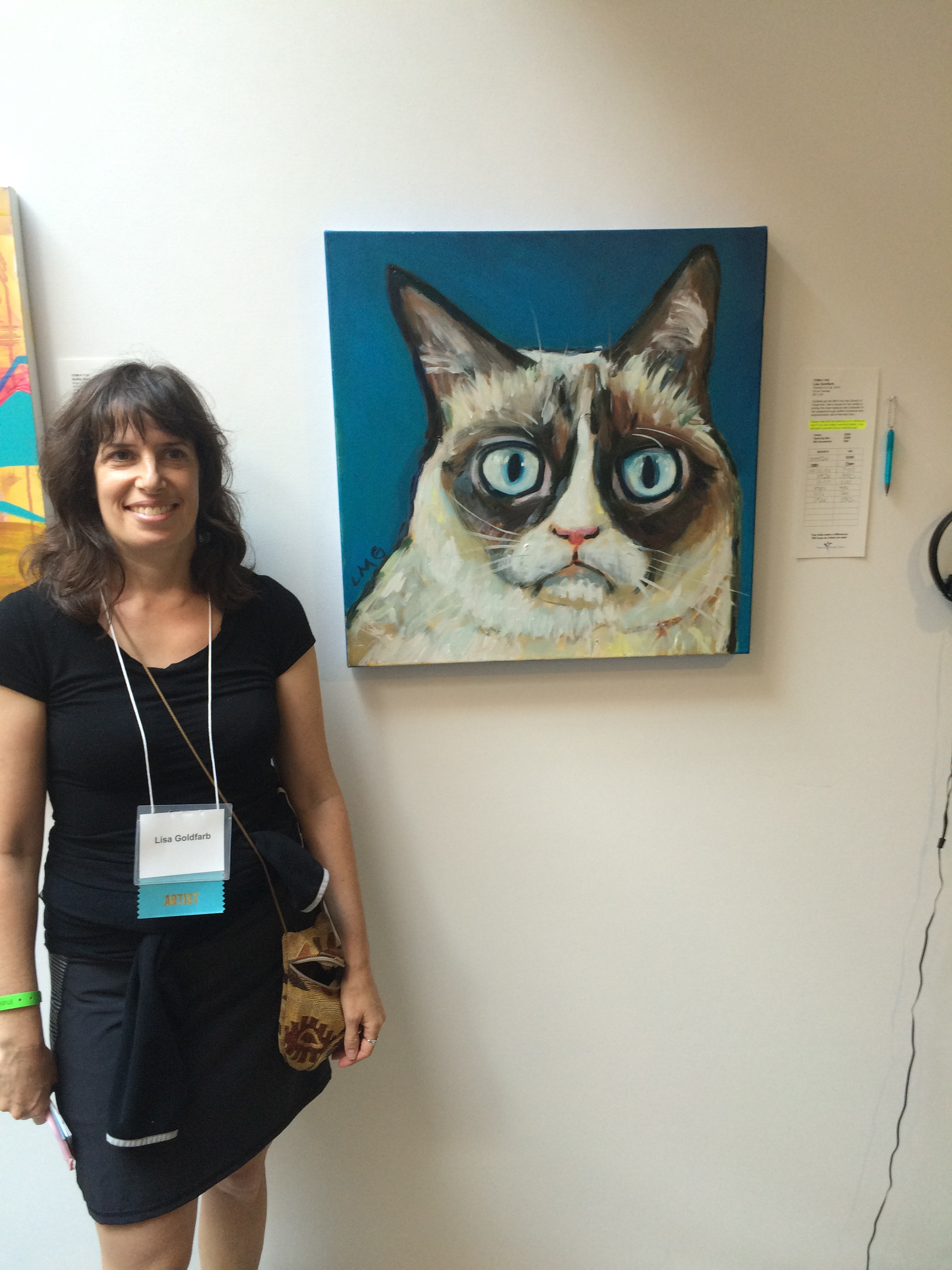 Lisa Goldfarb and her painting of Grumpy Cat at the Venice Family Clinic Art Auction